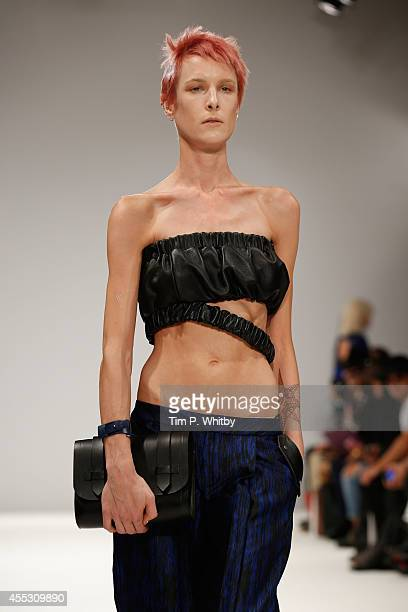 A model walks the runway at the Jamie Wei Huang show during London Fashion Week Spring Summer 2015 at Fashion Scout Venue on September 12 2014 in...