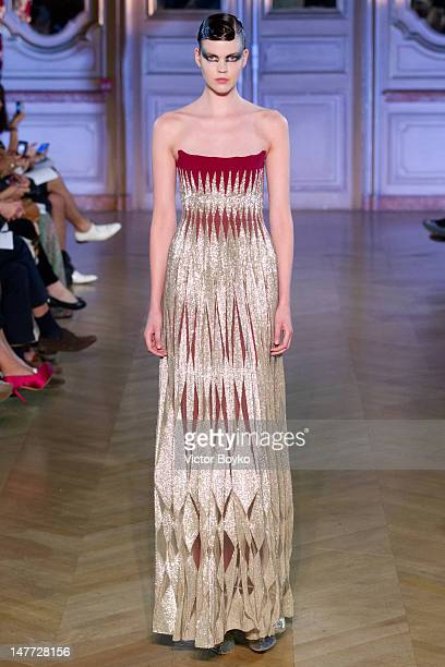 Model walks the runway at the Jantaminiau Haute-Couture Show as part of Paris Fashion Week Fall / Winter 2013 at Salle Erard on July 2, 2012 in...