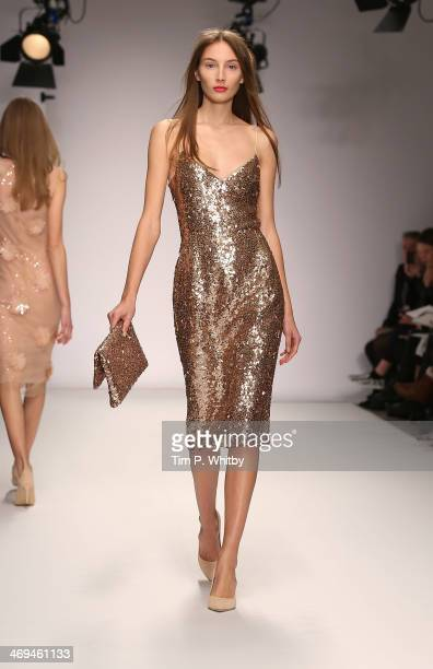 A model walks the runway at the Jasper Conran show at London Fashion Week AW14 at Saatchi Gallery on February 15 2014 in London England