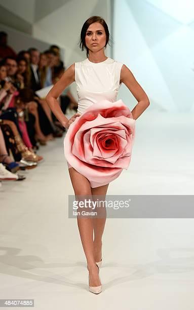 A model walks the runway at the Jean Louis Sabaji show during Fashion Forward at Madinat Jumeirah on April 11 2014 in Dubai United Arab Emirates