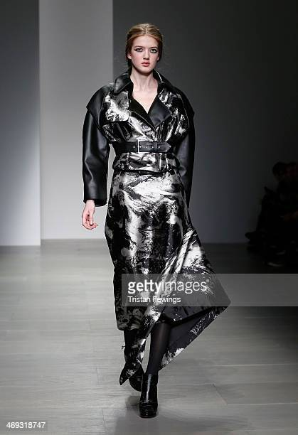 A model walks the runway at the JeanPierre Braganza show at London Fashion Week AW14 at Somerset House on February 14 2014 in London England