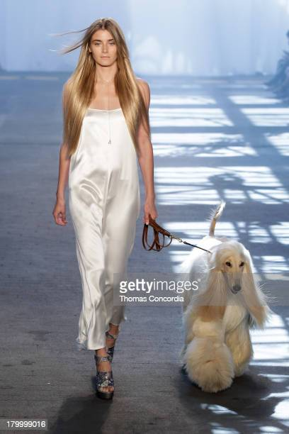 Model walks the runway at the Jen Kao Spring 2014 fashion show during Mercedes-Benz Fashion Week at Skylight at Moynihan Station in New York City on...