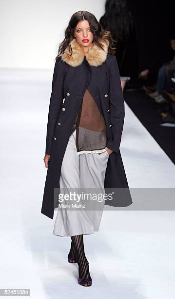A model walks the runway at the Jenni Kayne Fall 2005 show during MercedesBenz Fashion Week at Smashbox Studios March 18 2005 in Culver City...