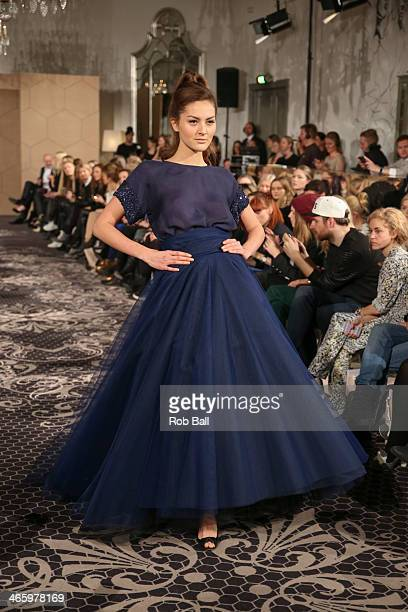 A model walks the runway at the Jesper Hovring show during Copenhagen Fashion Week AW14 on January 30 2014 in Copenhagen Denmark
