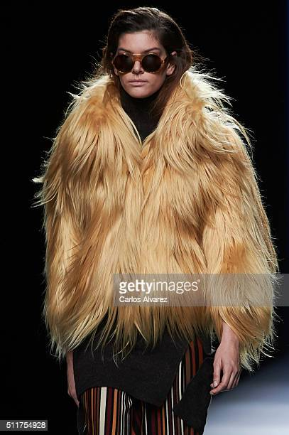 A model walks the runway at the Jesus Lorenzo show during the MercedesBenz Madrid Fashion Week Autumn/Winter 2016/2017 at Ifema on February 22 2016...