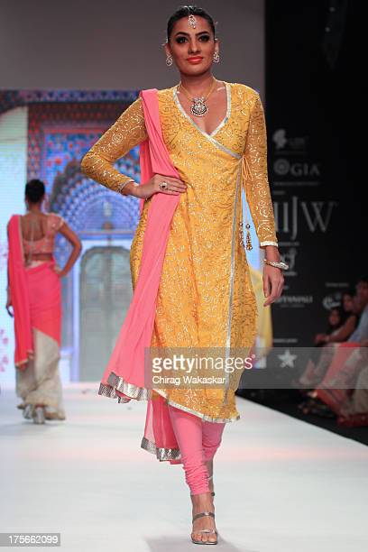 A model walks the runway at the Jewel Trendz show on day 2 of India International Jewellery Week 2013 at the Hotel Grand Hyatt on August 5 2013 in...
