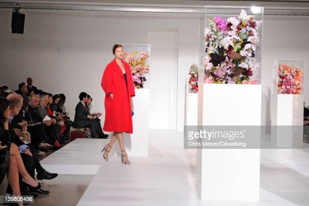 A model walks the runway at the Jil Sander Autumn Winter 2012 fashion show during Milan Fashion Week on February 25 2012 in Milan Italy