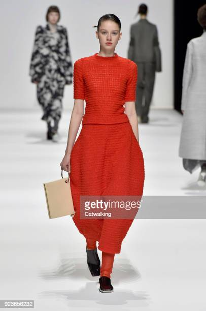 A model walks the runway at the Jil Sander Autumn Winter 2018 fashion show during Milan Fashion Week on February 24 2018 in Milan Italy