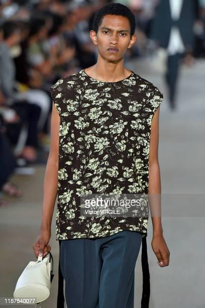 Model walks the runway at the Jil Sander fashion show during Paris Men's Fashion Week Spring/Summer 2020 on June 21, 2019 in Paris, France.