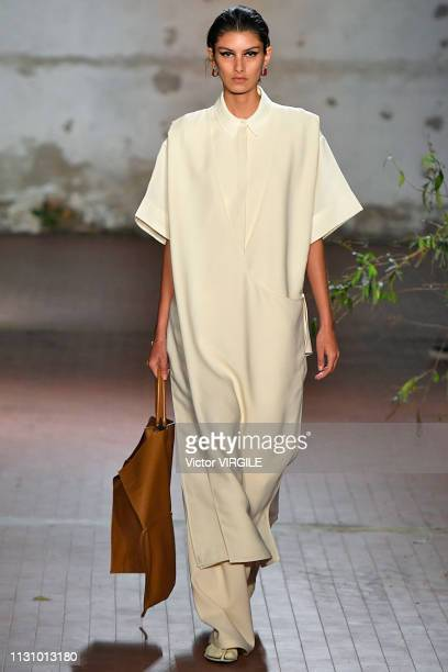 Model walks the runway at the Jil Sander Ready to Wear Fall/Winter 2019-2020 fashion show during Milan Fashion Week Autumn/Winter 2019/20 on February...
