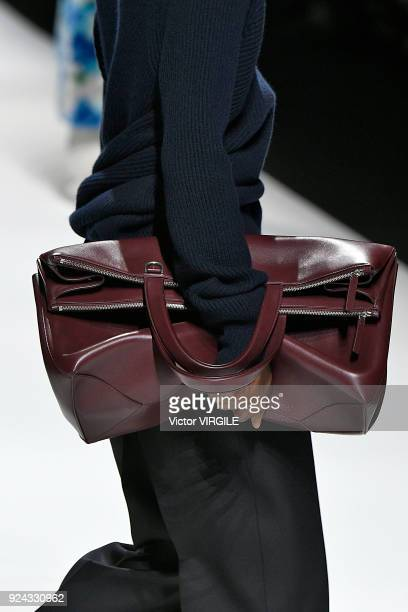 A model walks the runway at the Jil Sander Ready to Wear Fall/Winter 20182019 fashion show during Milan Fashion Week Fall/Winter 2018/19 on February...