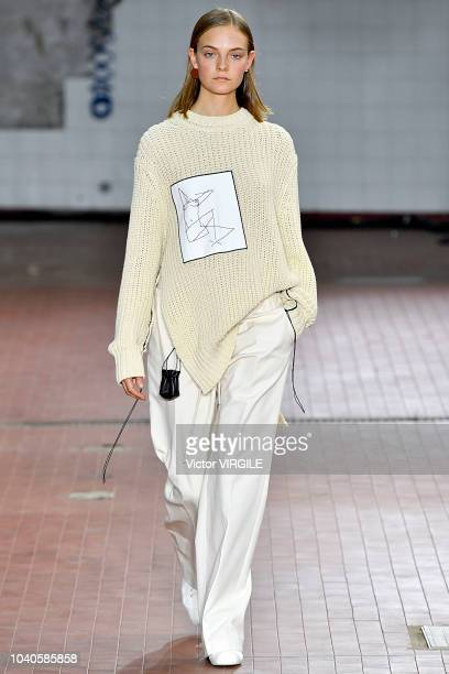 A model walks the runway at the Jil Sander Ready to Wear fashion show during Milan Fashion Week Spring/Summer 2019 on September 19 2018 in Milan Italy