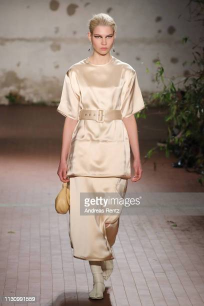 A model walks the runway at the Jil Sander show at Milan Fashion Week Autumn/Winter 2019/20 on February 20 2019 in Milan Italy