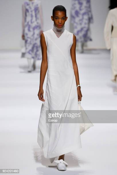 A model walks the runway at the Jil Sander show during Milan Fashion Week Fall/Winter 2018/19 on February 24 2018 in Milan Italy