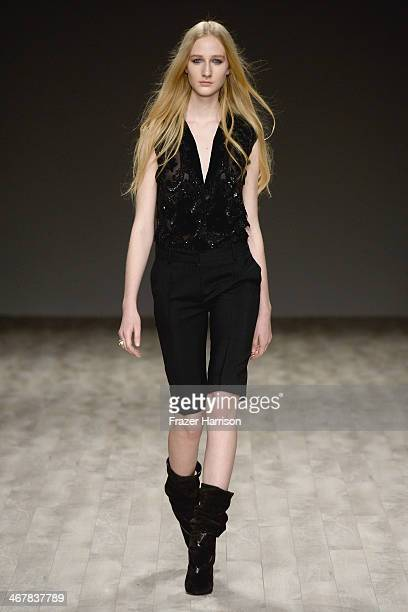 Model walks the runway at the Jill Stuart fashion show during Mercedes-Benz Fashion Week Fall 2014 at The Salon at Lincoln Center on February 8, 2014...