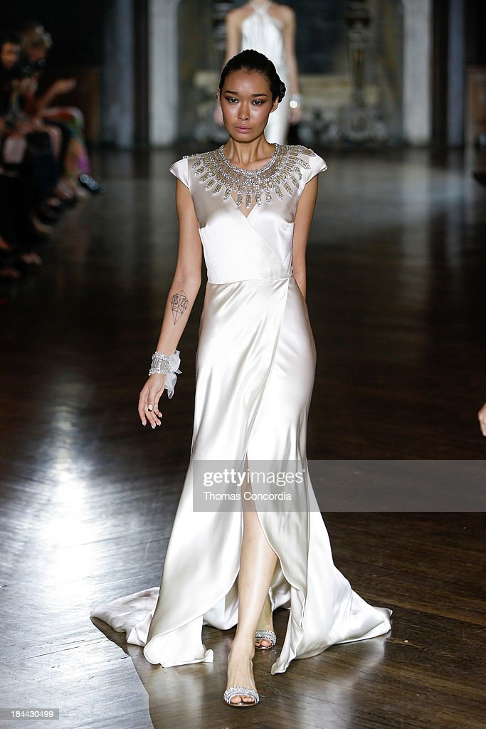 A model walks the runway at the Johanna Johnson Fall 2014 Bridal collection show on October 13, 2013 in New York City.