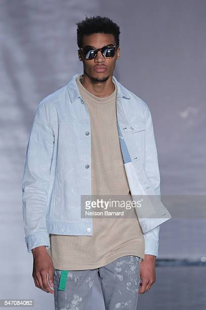 Model walks the runway at the John Elliott fashion show during New York Fashion Week: Men's S/S 2017 at Skylight Clarkson Sq on July 13, 2016 in New...