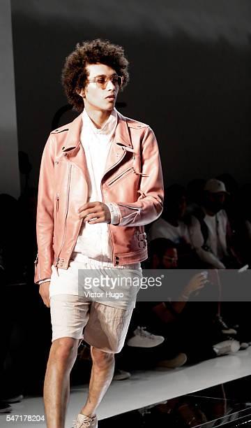 Model walks the runway at the John Elliott presentation during New York Fashion Week: Men's S/S 2017 at Skylight Clarkson Sq on July 13, 2016 in New...