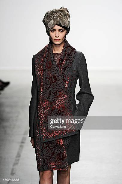 A model walks the runway at the John Galliano Autumn Winter 2014 fashion show during Paris Fashion Week on March 2 2014 in Paris France