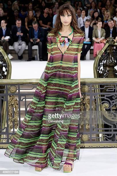 Model walks the runway at the John Galliano Spring Summer 2015 fashion show during Paris Fashion Week on September 28, 2014 in Paris, France.