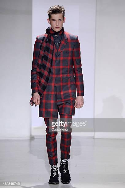 A model walks the runway at the John Lawrence Sullivan Autumn Winter 2014 fashion show during Paris Menswear Fashion Week on January 15 2014 in Paris...