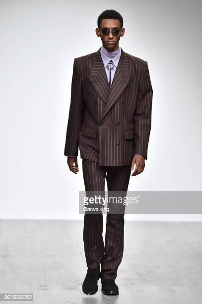 Model walks the runway at the John Lawrence Sullivan Autumn Winter 2018 fashion show during London Menswear Fashion Week on January 6, 2018 in...