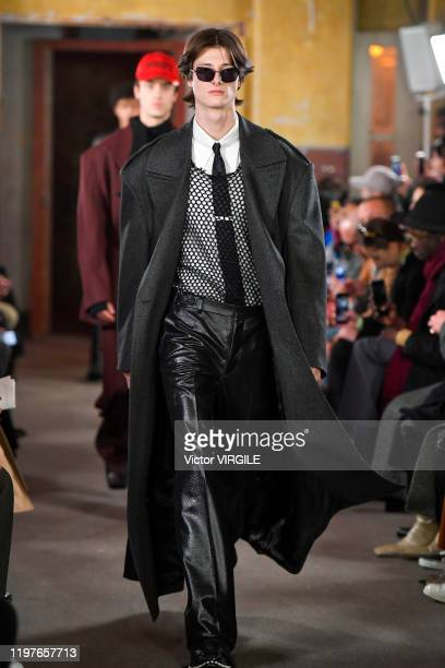 A model walks the runway at the John Lawrence Sullivan Fall/Winter 20202021 show during London Fashion Week Men's January 2020 on January 04 2020 in...