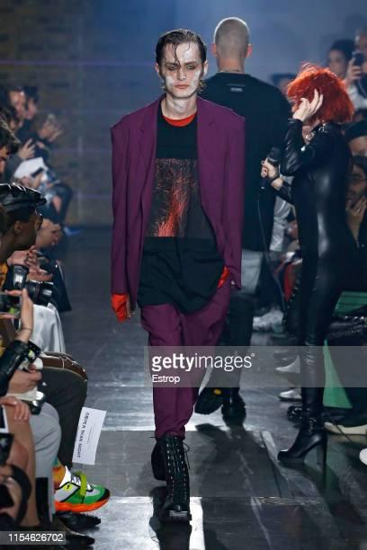 Model walks the runway at the John Lawrence Sullivan fashion show during London Fashion Week Men's June 2019 on June 8, 2019 in London, England.