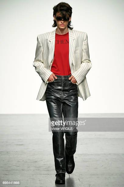 Model walks the runway at the John Lawrence Sullivan fashion show during the London Fashion Week Men's June 2017 Spring Summer 2018 collections on...