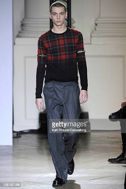 Model walks the runway at the John Lawrence Sullivan menswear fashion show during Paris Fashion Menswear Week on January 20, 2011 in Paris, France.
