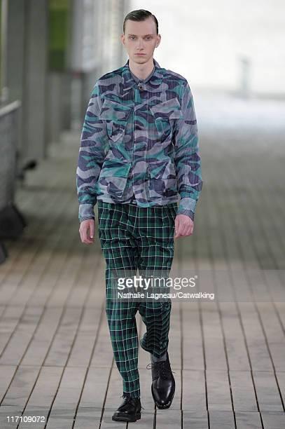 Model walks the runway at the John Lawrence Sullivan menswear fashion show during Paris Fashion Menswear Week on June 22, 2011 in Paris, France.
