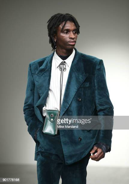 Model walks the runway at the John Lawrence Sullivan show during London Fashion Week Men's January 2018 at BFC Show Space on January 6, 2018 in...