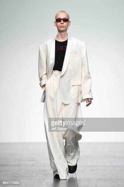 Model walks the runway at the John Lawrence Sullivan show during the London Fashion Week Men's June 2017 collections on June 11, 2017 in London,...