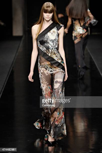 A model walks the runway at the John Richmond Autumn Winter 2014 fashion show during Milan Fashion Week on February 23 2014 in Milan Italy