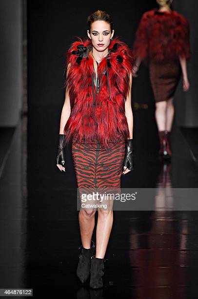 A model walks the runway at the John Richmond Autumn Winter 2015 fashion show during Milan Fashion Week on March 1 2015 in Milan Italy
