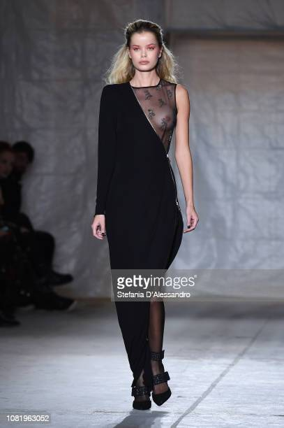 A model walks the runway at the John Richmond show during Milan Menswear Fashion Week Autumn/Winter 2019/20 on January 13 2019 in Milan Italy