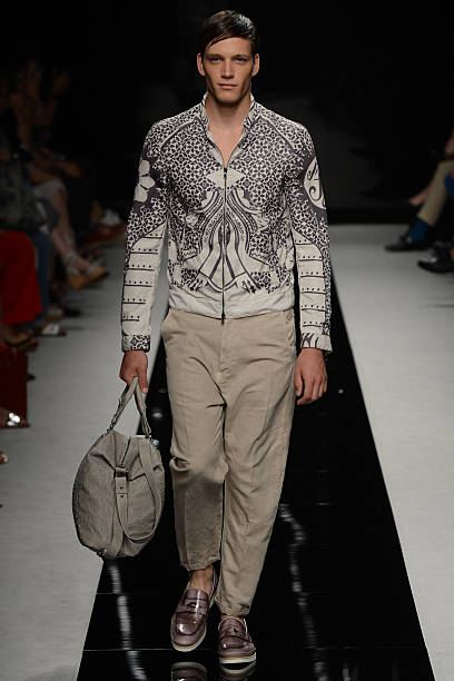 af39ee37b955 A model walks the runway at the John Richmond Spring Summer 2013 fashion  show during Milan