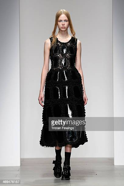 A model walks the runway at the John Rocha show during London Fashion Week AW14 at Somerset House on February 15 2014 in London England