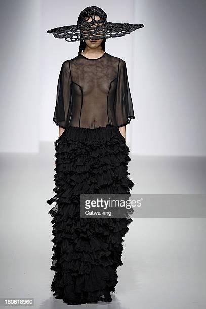 A model walks the runway at the John Rocha Spring Summer 2014 fashion show during London Fashion Week on September 14 2013 in London United Kingdom