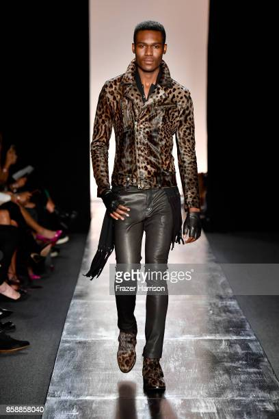 A model walks the runway at the John Varvatos Fashion Show at South Coast Plaza on October 7 2017 in Costa Mesa California