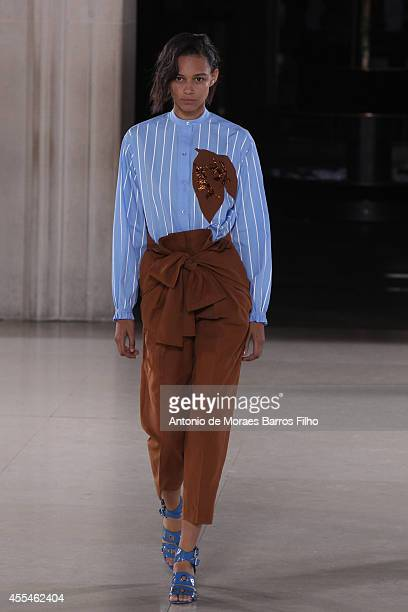 A model walks the runway at the Jonathan Saunders show during London Fashion Week Spring Summer 2015 at on September 14 2014 in London England