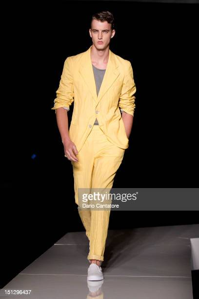 Model walks the runway at the Joseph Abboud spring 2013 fashion show during Mercedes-Benz Fashion Week at New York Public Library on September 5,...