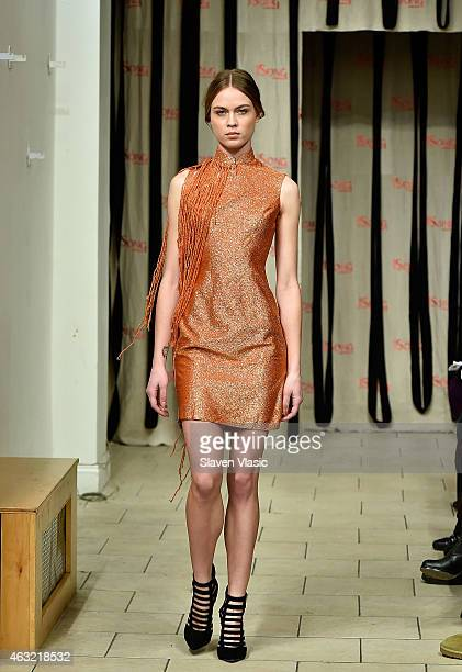 A model walks the runway at the JSong International Inc show during the MercedesBenz Fashion Week Fall 2015 on February 11 2015 in New York City