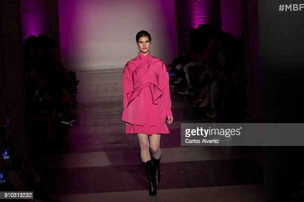 A model walks the runway at the Juan Vidal fashion show during the Mercedes Benz Fashion Week Autumn/Winter 2018 at the Casa de Correos on January 25...