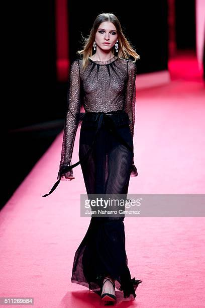 A model walks the runway at the Juanjo Oliva show during the MercedesBenz Madrid Fashion Week Autumn/Winter 2016/2017 at Ifema on February 19 2016 in...