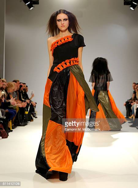 A model walks the runway at the Judy Wu show at Fashion Scout during London Fashion Week Autumn/Winter 2016/17 at Freemasons' Hall on February 20...