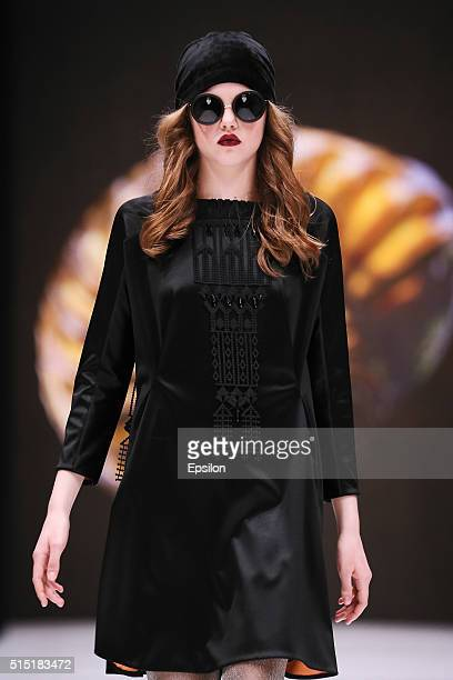 A model walks the runway at the Julia Dalakian fashion show during day two of Mercedes Benz Fashion Week Russia FW16/17 at Manege on March 12 2016 in...