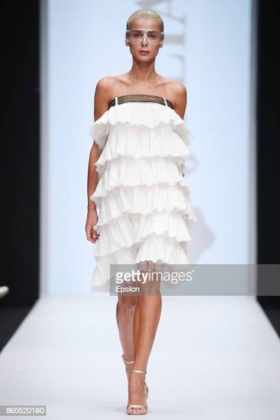 A model walks the runway at the Julia Dalakian fashion show during day three of Mercedes Benz Fashion Week Russia S/S 2018 at Manege on October 23...