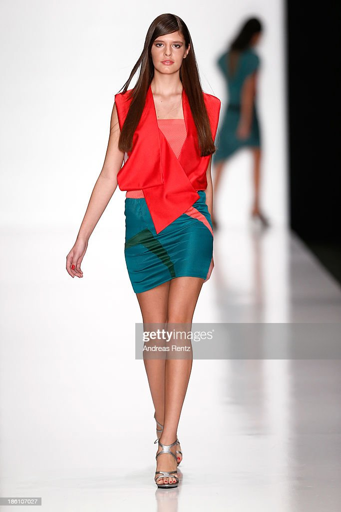 A model walks the runway at the Julia Dalakian show during Mercedes-Benz Fashion Week Russia S/S 2014 on October 28, 2013 in Moscow, Russia.