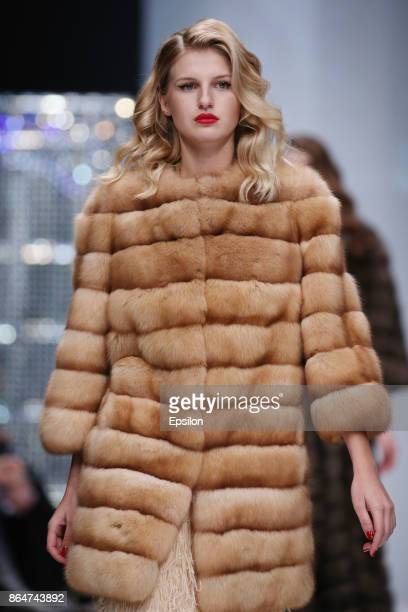 A model walks the runway at the Julia Dilua fashion show during day one of Mercedes Benz Fashion Week Russia S/S 2018 at Manege on October 21 2017 in...